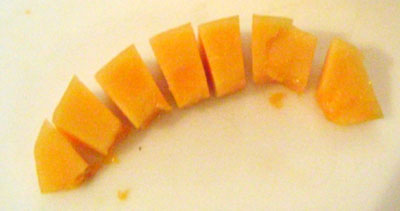 Cut each peeled cantaloupe slice into chunks