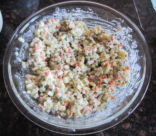 adding mayo to salad olivier