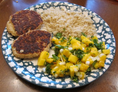 mango salsa with parsley served with salmon fish cakes