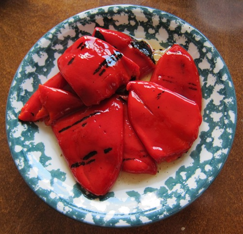 marinated roasted red peppers on a plate
