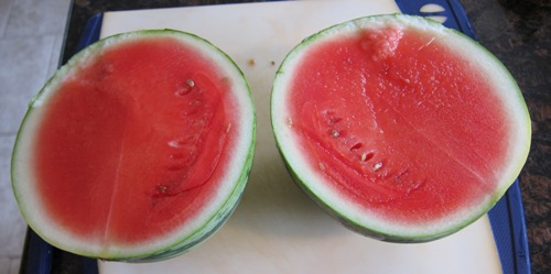 red juicy watermelon cut in half