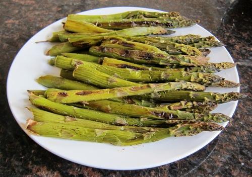 roasted asparagus served on a plate