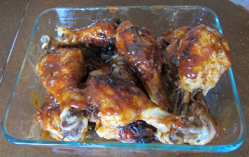 dish with barbecued chicken legs