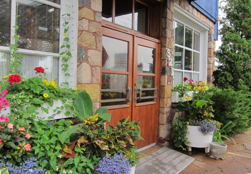 the cheese factory restaurant front door and garden