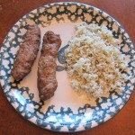 kefta kabob with dill rice on a plate