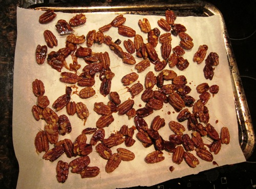 candied nuts drying on parchment paper