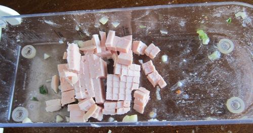 bologna chopped in the onion chopper
