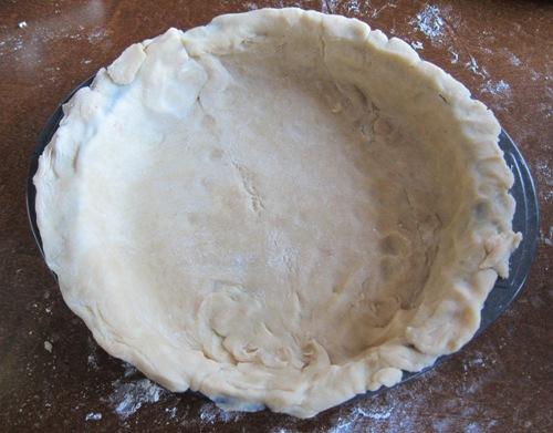 pie dough bottom crust in a pie pan