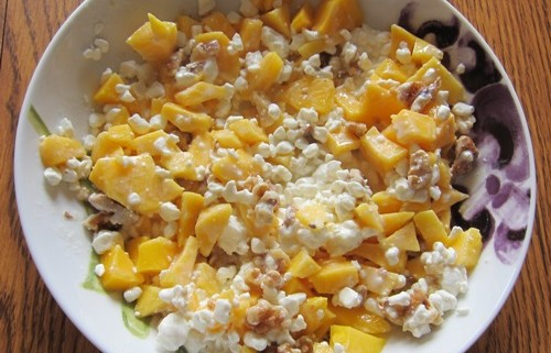 cottage cheese with chopped mango and walnuts