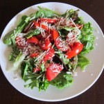 salad with lettuce tomato and shredded parmesan cheese