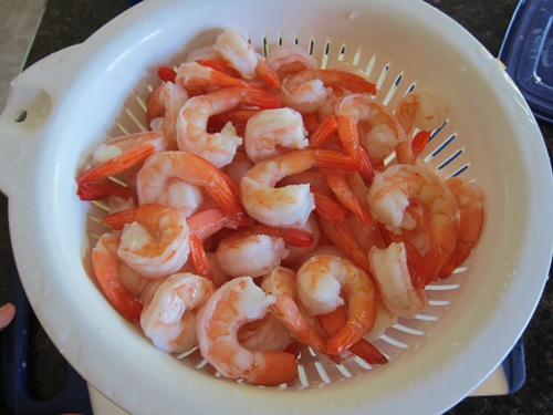 defrost shrimp in a colander