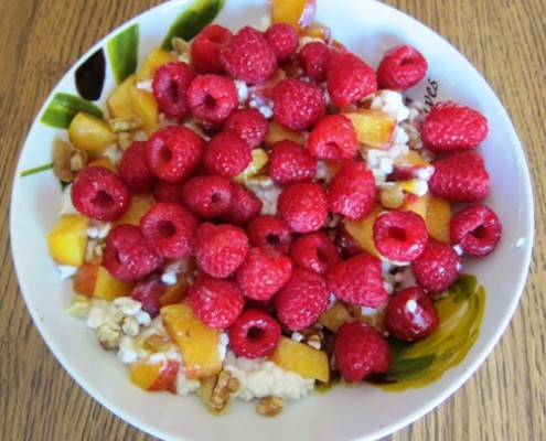 cottage cheese with raspberries peaches and walnuts