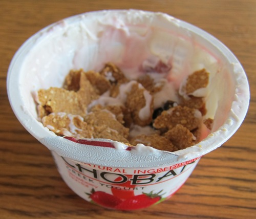 raisin bran cereal mixed with yogurt