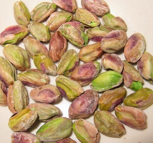 green pistachios nuts closeup