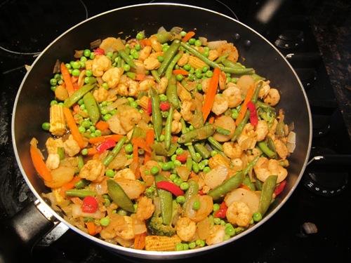 shrimp stir fry on a frying pan
