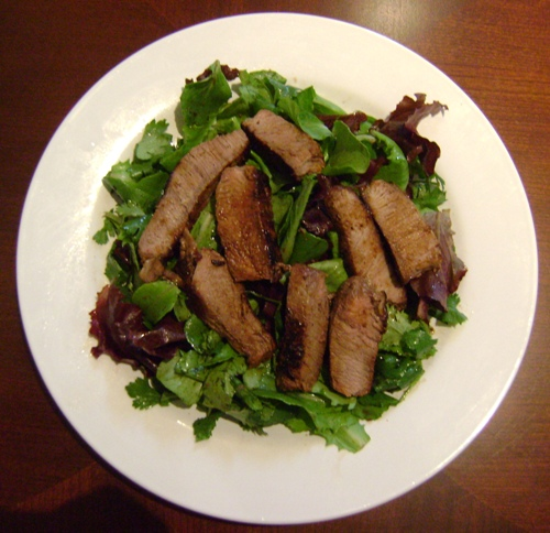 grilled slices steak and green lettuce salad recipe