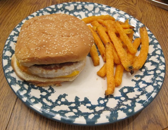 turkey cheeseburger on the plate with sweet potato fries