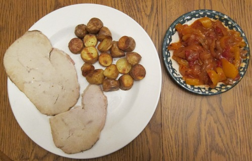 dinner of turkey breast with small potatoes and peppers