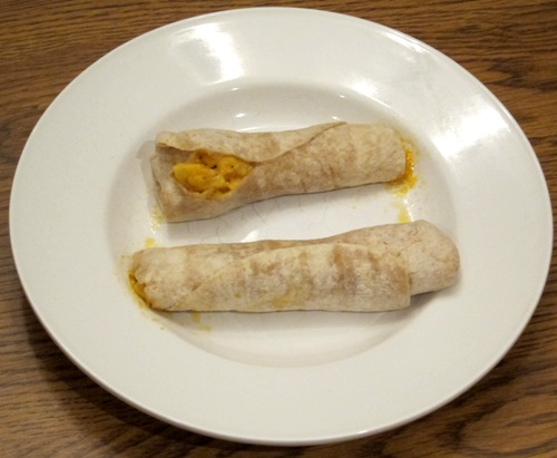 egg cheese and sausage wrap cooked on a plate