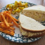 chicken salad sandwich with mango salsa and sweet potato fries