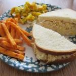 chicken salad sandwich with mango salsa and sweet potato fries