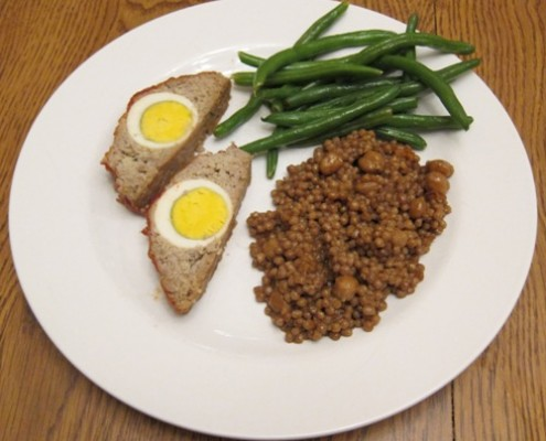 stuffed meatloaf with egg, green beans and couscous