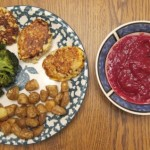 dinner of salmon fishcakes, roasted new potatoes, broccoli and cocktail sauce