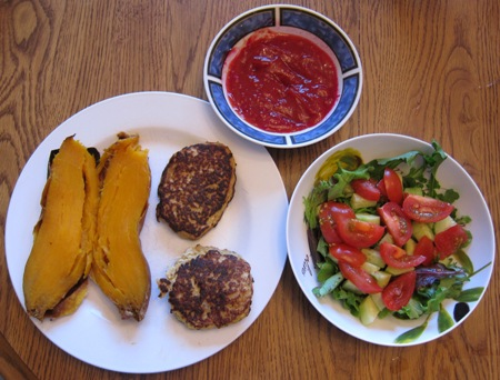 salmon fishcakes, baked sweet potato, cocktail sauce and salad