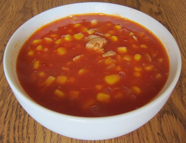 corn, chicken and tomato soup in a bowl
