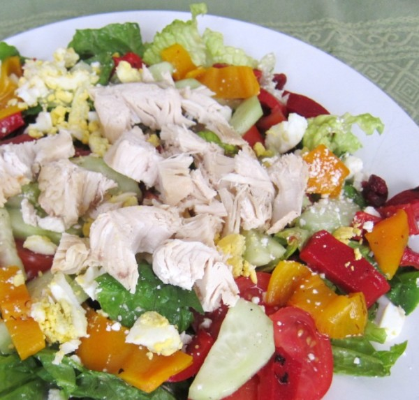 chopped green salad with chicken and roasted peppers