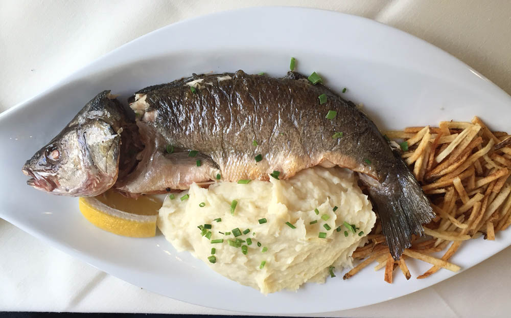 Whole fish with mashed potatoes at Deka