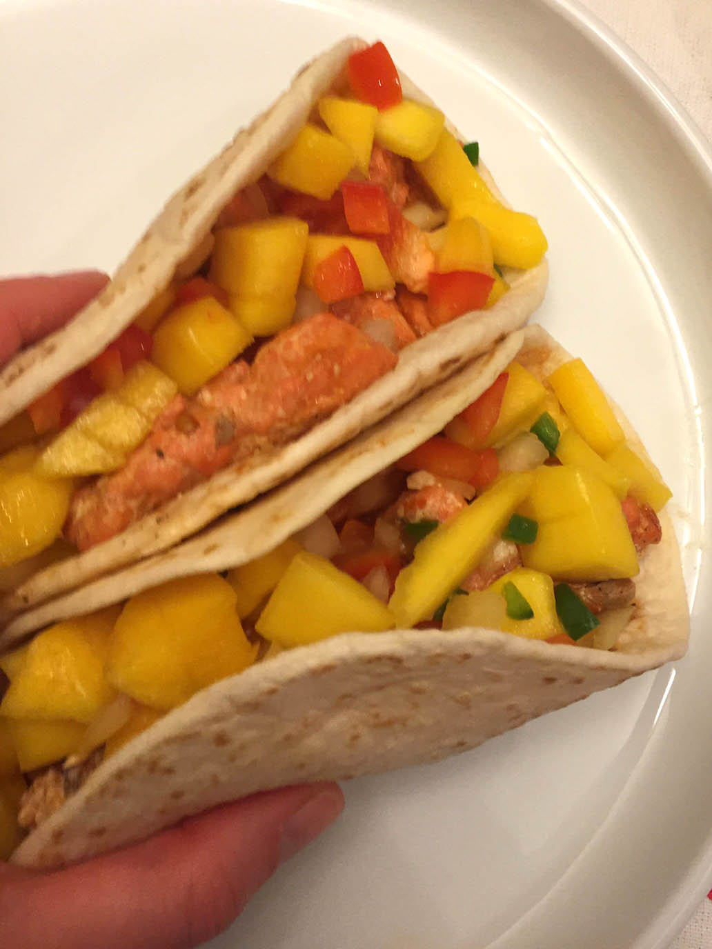 Easy fish tacos recipe with mango salsa melanie cooks for Making fish tacos