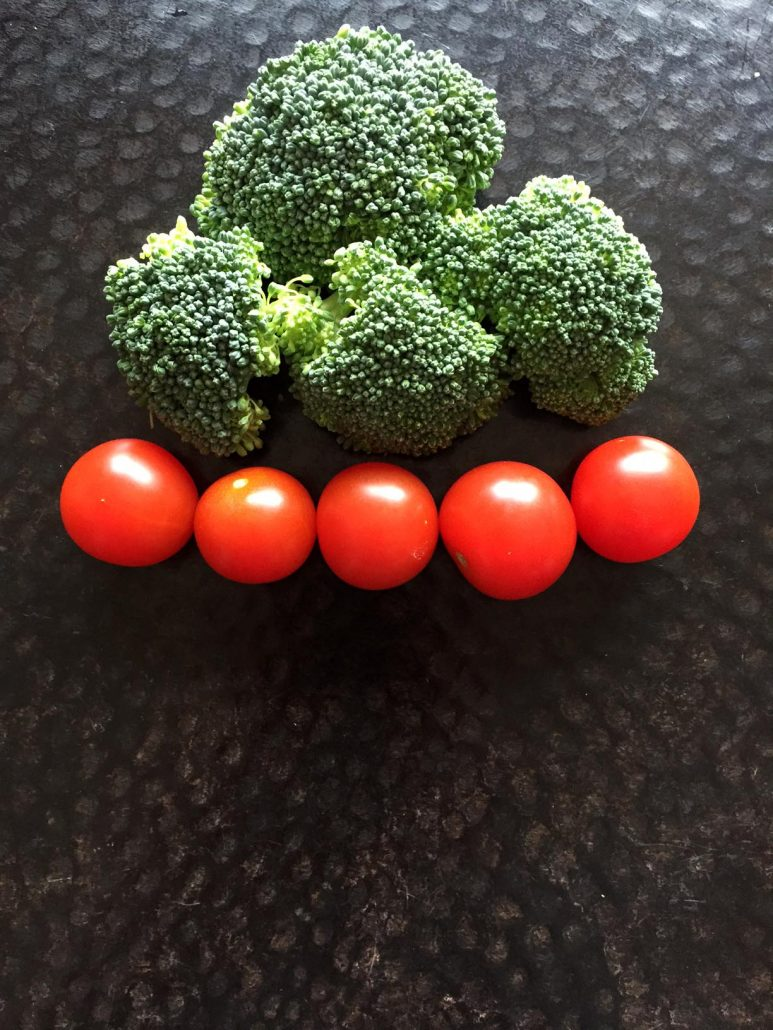 Broccoli and tomato Christmas tree
