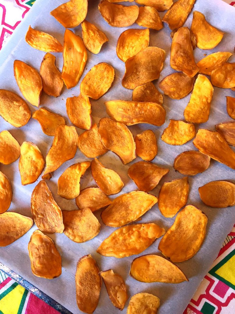 Baked Sweet Potato Chips On A Baking Sheet