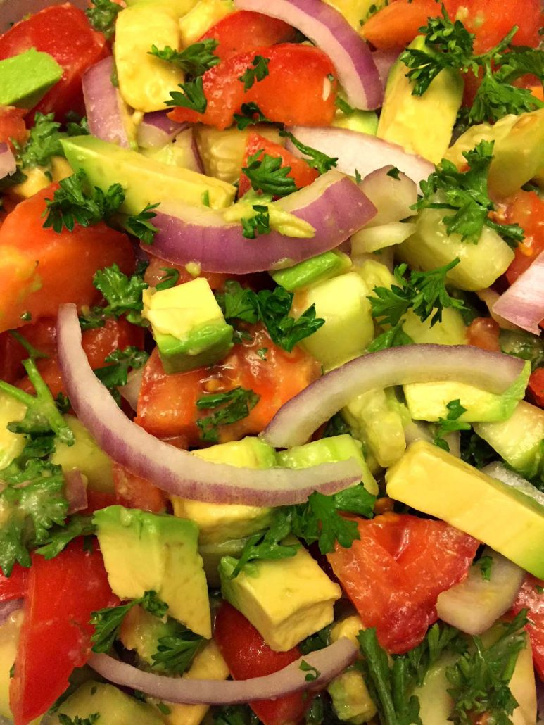 Tomato cucumber onion salad with avocado