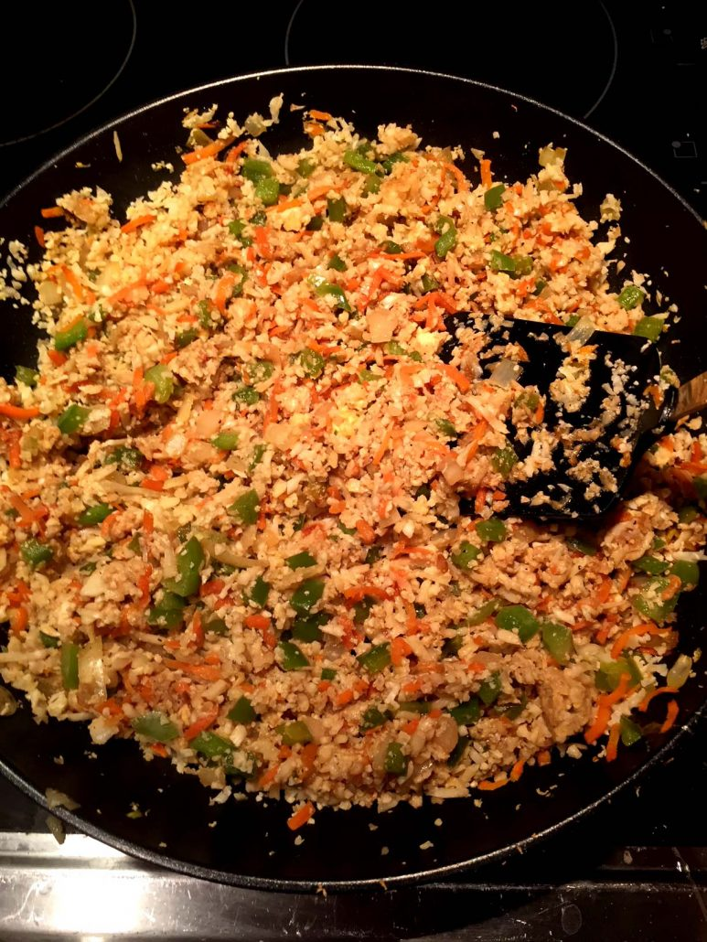 Making Cauliflower Fried Rice On A Frying Pan