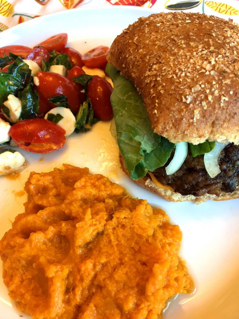 Burger and mashed sweet potatoes dinner