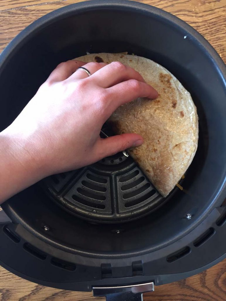 Folding the quesadilla