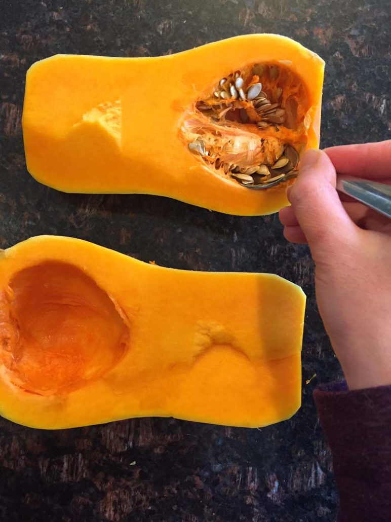 Removing the seeds from butternut squash