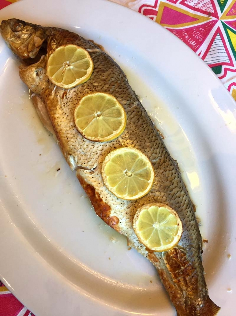 whole whitefish on a platter