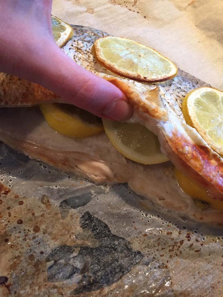 stuffing whole whitefish with lemons