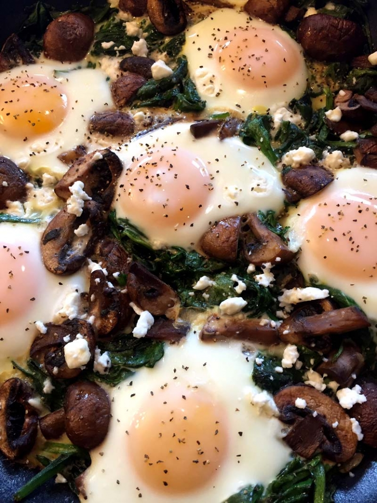 low carb eggs in a nest with spinach and mushrooms