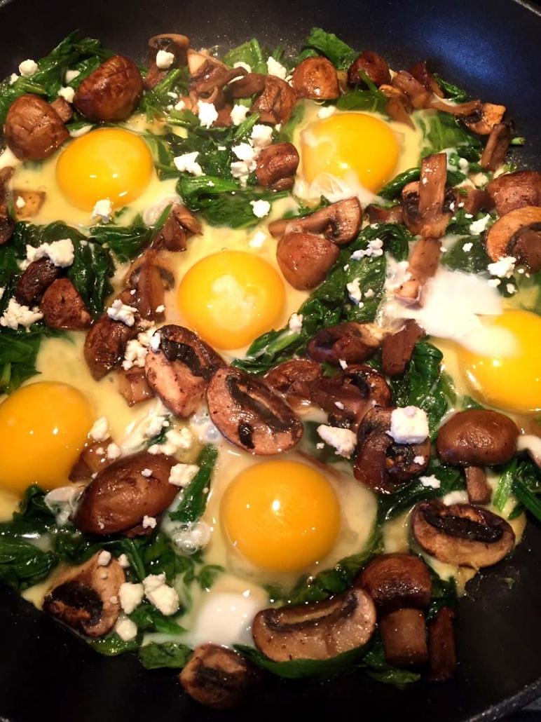 spinach mushroom feta eggs in a nest