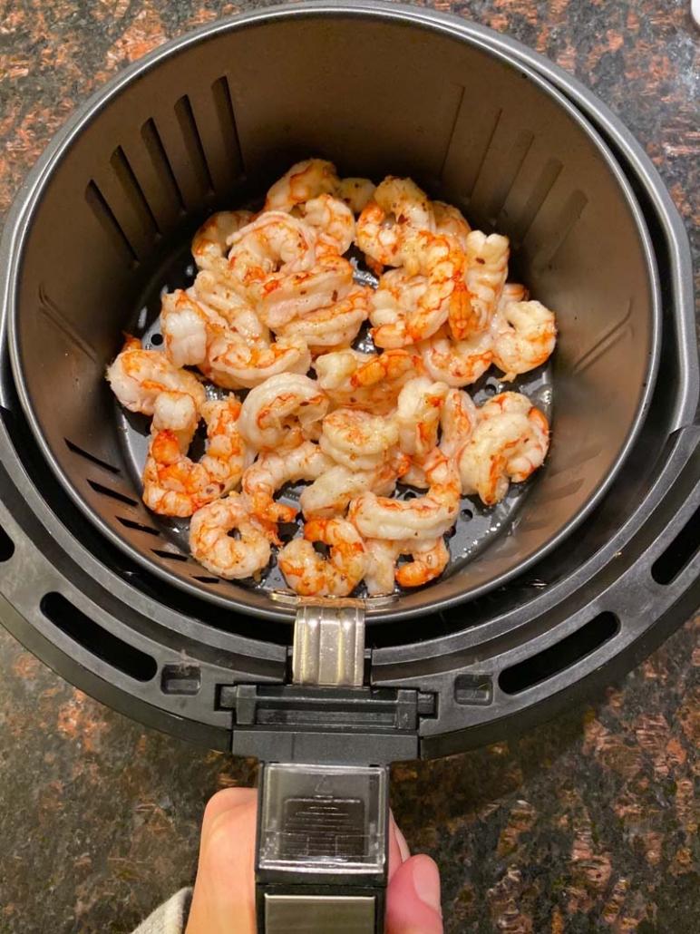 Cooked Frozen Shrimp in an air fryer basket