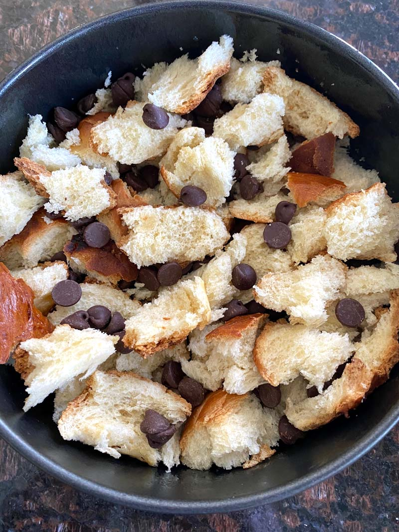 Bread and chocolate chips in a pan