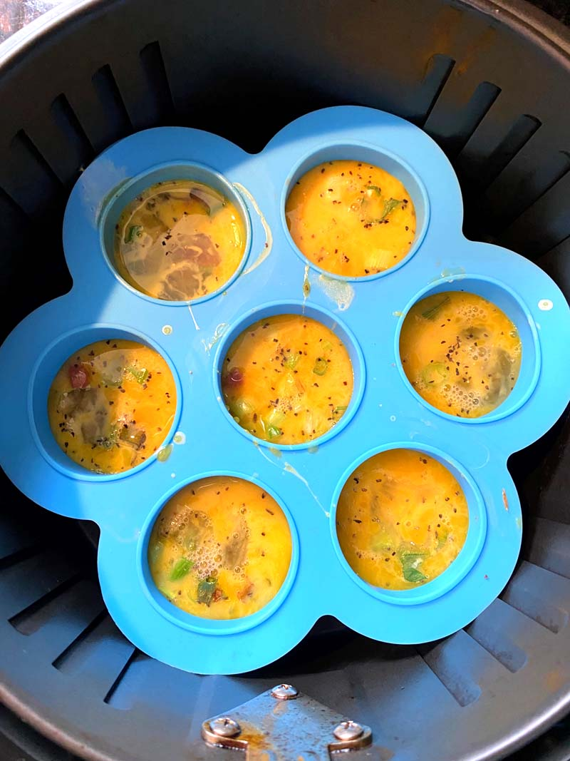 Eggs bites in a mold in the air fryer basket