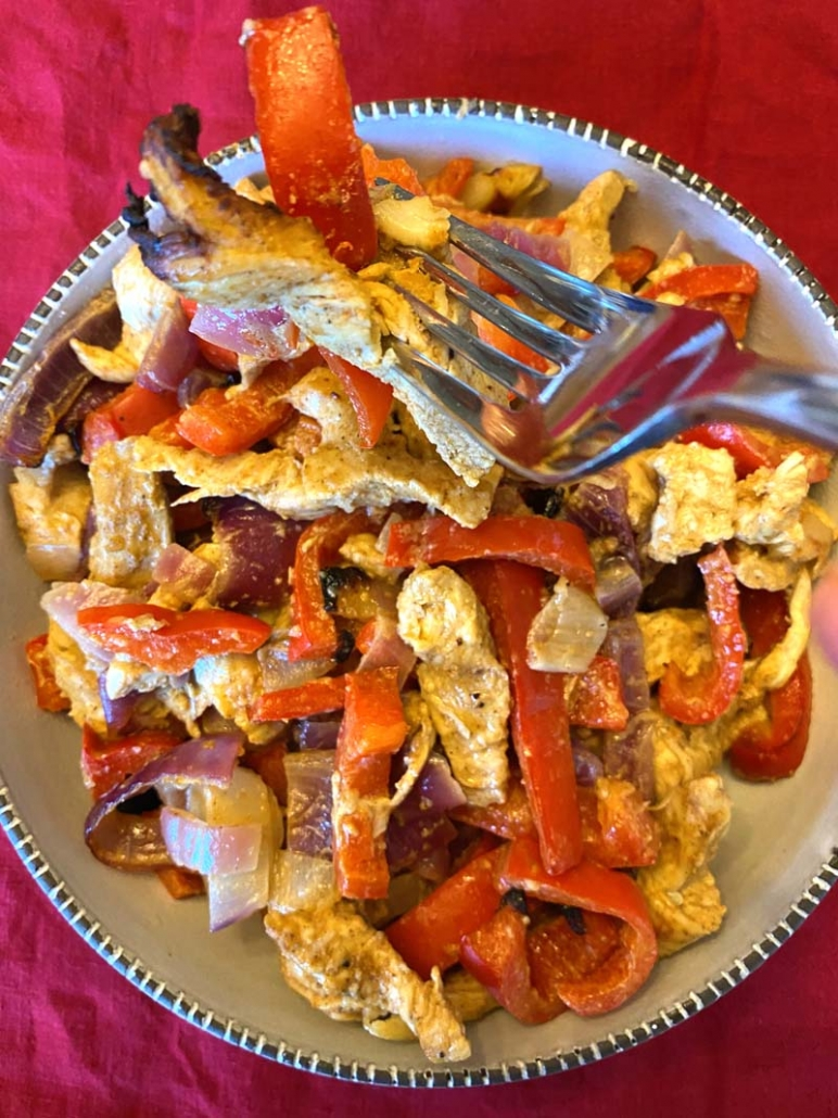 eating chicken with peppers and onions