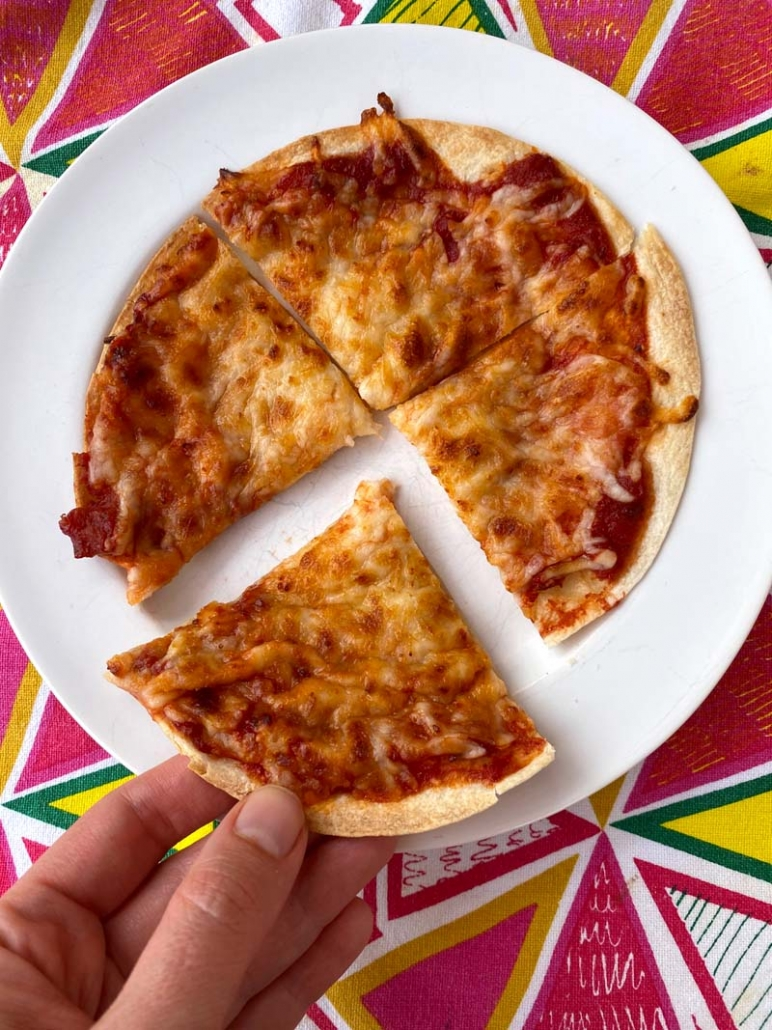 sliced up tortilla pizza with cheese