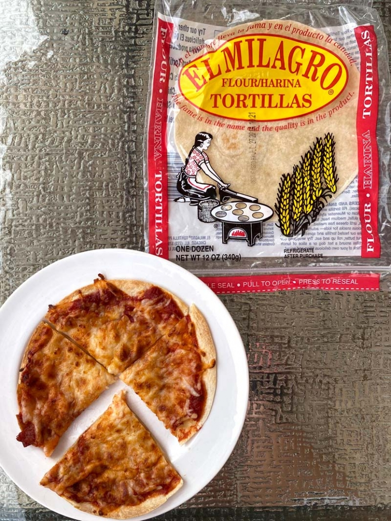making pizzas with flour tortillas