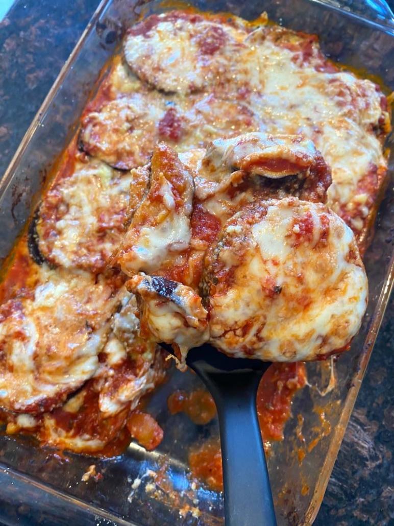 Serving keto baked eggplant parmesan